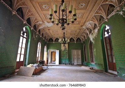 """THURINGIA, GERMANY - NOV 05,2016: Abandoned castle """"Schloss Rapunzel"""", located in Thuringia a few hundred kilometers from Berlin. Beautiful neo-gothic palace. Green Hall"""