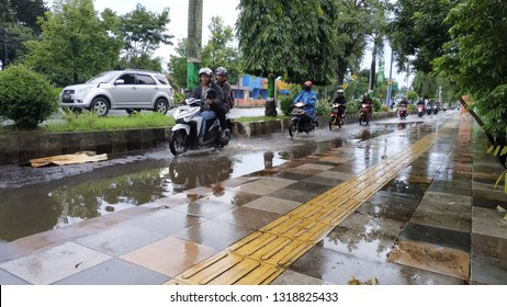 Thursday 21 February 2019, Pati, Central Java, Indonesia : heavy rain made motorbike riders careful