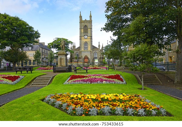 THURSO, SCOTLAND - AUGUST 8, 2017: Sir John Square of Thurso and St Peter's and St Andrew's church. Thurso is a town on the north coast of the Highland council area of Scotland.