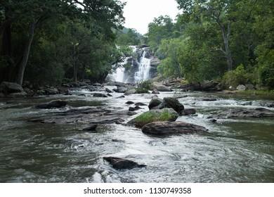 Thuvanam Waterfalls located in the Chinnar Wildlife Sanctuary near Munnar Kerala. Fresh flowing river water through the forest. Kerala flood water from Idukki dam .