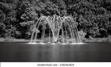 Thw Woodlands, TX USA  - Jul. 16, 2018  -  Fountain in a Pond B&W