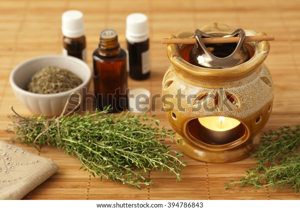 Thyme aromatherapy oil, herbs and chimney