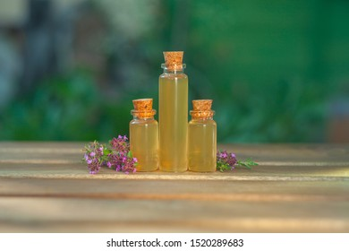thyme essential oil in a beautiful bottle on the table