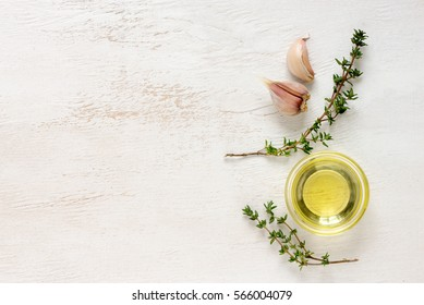 Thyme and garlic infused culinary oil, view from above, blank space for a text