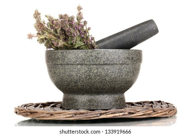 Thyme herb and mortar on wicker mat isolated on white