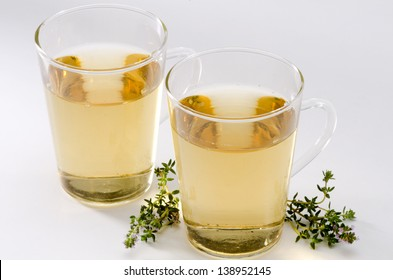 Thyme Herbal Tea in a glass cup. Thymus vulgaris. Naturopathy. White Background.