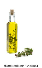 Thyme infused olive oil over white background