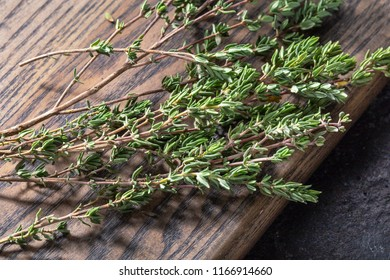 Thyme on wood background.