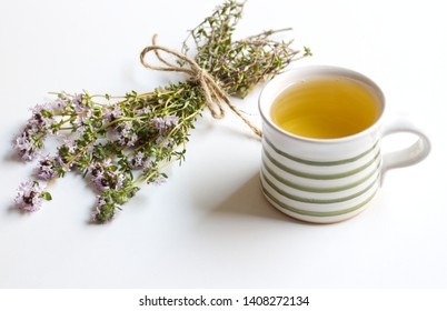 Thyme tea and thyme leaves. Infusion made from thyme leaves. Medicinal herb Thymus vulgaris. The concept of healthy nutrition.