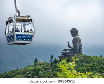 Tian Tan big Buddha and Ngong Ping cable car with green mountain in background, the famous and popular travel place in HongKong.
