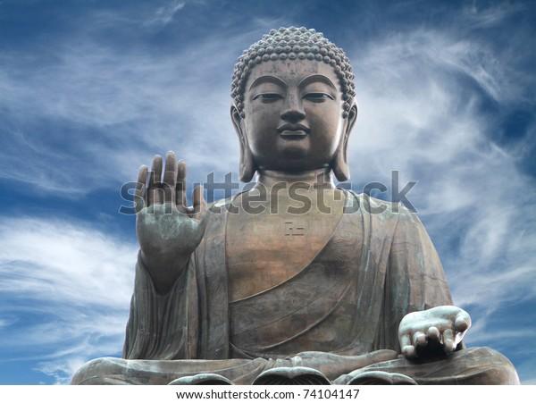 The Tian Tan Buddha in Hong Kong in a  dramatic sky background