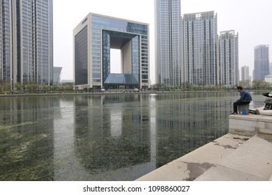 TIANJIN, CHINA - APRIL 8, 2017. A modern building along the Haihe River in Tianjin, China.
