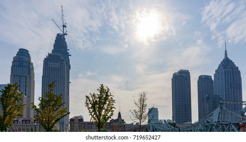 Tianjin, China - Nov 1, 2016: Commercial skyline across the Haihe River. Buildings in contrasting modern and old architectural style.