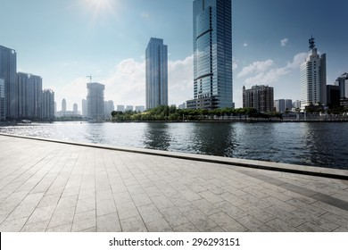 Tianjin,China-May 22,2015:modern building exterior with brick road floor in Tianjin at riverbank