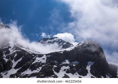 Tian-Shan Mountains landscape with clouds, Kazakhstan.