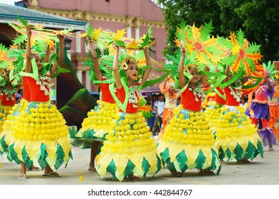 TIAONG, QUEZON, PHILIPPINES - JUNE 22, 2016: a group of street dancers in various costumes dance at church plaza to celebrate the feast of St. John the Baptist