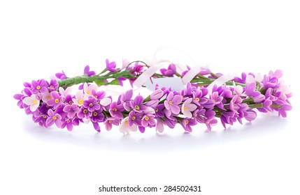 tiara of artificial flowers isolated on white background