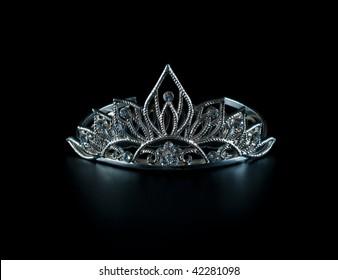 Tiara or diadem with reflection on dark background