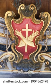 TIBER ISLAND, ROME, ITALY - JANUARY 9, 2021: Basilica of St Bartholomew on the Island. Franciscan Order's Emblem: the Right Arm Represents That of Christ, the Left That of Saint Francis of Assisi