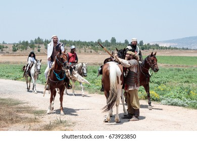 Tiberias, Israel, July 01, 2017 : Participants in the reconstruction of Horns of Hattin battle in 1187 left the camp on horseback and go to the battle site near TIberias, Israel