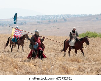 Tiberias, Israel, July 01, 2017 : Participants in the reconstruction of Horns of Hattin battle in 1187 moving around the battlefield near Tiberias, Israel