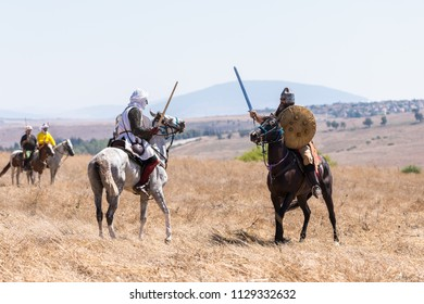 Tiberias, Israel, July 07, 2018 : Reconstruction of Horns of Hattin battle in 1187. A rider from Saladin's army is fighting a rider from the Crusader troops on the battlefield.