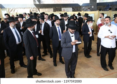 """TIBERIAS, ISRAEL- MAY 14, 2018: A group of Jewish men stand together in prayer by the graves of Maimonides and the Rabbi """"Shlah"""" as an omen for good children in Tiberias, Israel"""