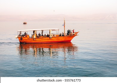 Tiberias, Israel - November 15, 2014: Evening walk on the boat on the Sea of Galilee.