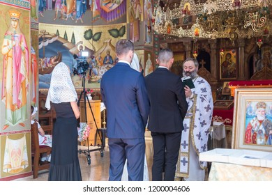 Tiberias, Israel, September 22, 2018 : A priest reads a prayer at the wedding ceremony held in the Orthodox tradition in Greek Orthodox monastery of the twelve apostles in Capernaum (Cafarnaum)