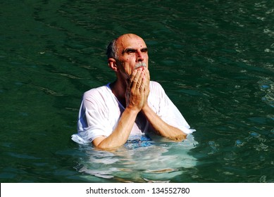 TIBERIAS - MAY 18:Christian pilgrim during mass baptism ceremony at the Jordan River in North Israel on May 18 2009.In Christian tradition, Jesus was baptised in the River Jordan by John the Baptist.