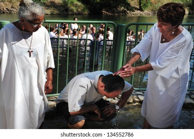 TIBERIAS - MAY 18:Christian pilgrims during mass baptism ceremony at the Jordan River in North Israel on May 18 2009.In Christian tradition, Jesus was baptised in the River Jordan by John the Baptist.