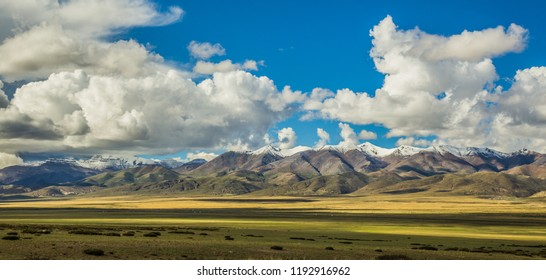 Tibet Ali area, high mountains, blue sky and white clouds, Gangdese Mountains