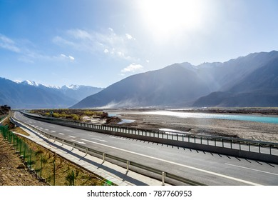 Tibet highway and snow-capped mountains