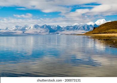 Tibet. Lake Mansarovar. Early morning.Mountain Lake. Against the backdrop of snow-capped Himalayan mountains.