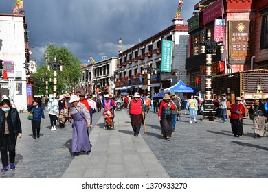 Tibet, Lhasa, China, June, 02, 2018.   People walk along the ancient Barkhor street on a summer day in cloudy weather