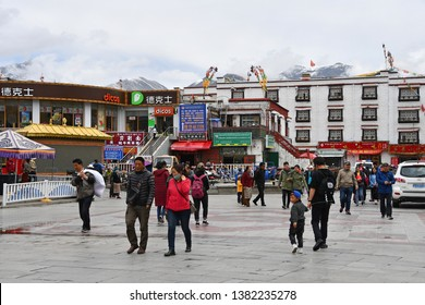 Tibet, Lhasa, China, June, 03, 2018. Motorbikes on the street in the historical center of Lhasa in front of the pharmacy and chain fast food restaurant Dicos. Tibet, China