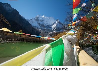 Tibet prayer flags and Xiannairi peak, Yading, Sichuan, China