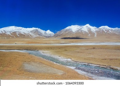 Tibet scenic view. Landscape of Tanggula mountain from Lhasa Xining train at Tibet travelling. Beautiful nature of high mountain from Tibet railway route.