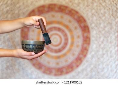 Tibetan bowl in woman's hands