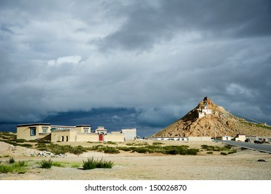 A Tibetan Buddhist Monastery perched on a hill in the Tibetan Landscape, China