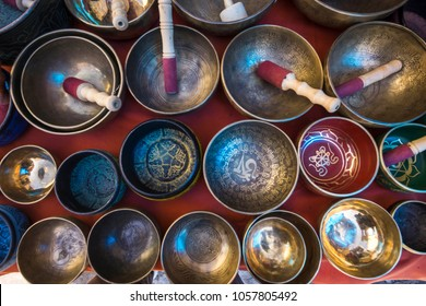 """Tibetan Buddhist singing bowls on the market in Leh town, India. TRANSLATION from Tibetan language: """"Pearl in the lotus flower"""", Ladakh, India"""