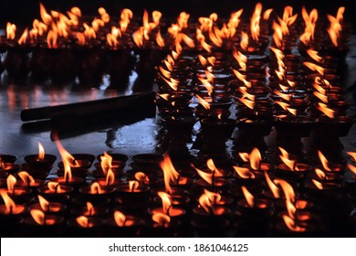 Tibetan butter lamps burning in a temple in Dharamsala, India