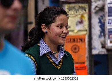 A tibetan girl wearing school uniform seen smiling in the streets. Shot in Dharamshala India May 2012