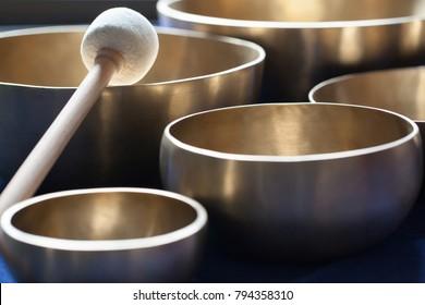 Tibetan Himalayan singing bowls with a wooden stick.