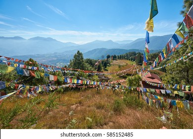 Tibetan monastery on the top of the hill with mountains and valley in the background in Dakshinkali, Nepal