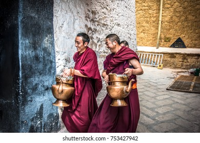 Tibetan monks are bringing the water in monastery kitchen. Picture was taken in Lhasa, Tibet in July 2017.