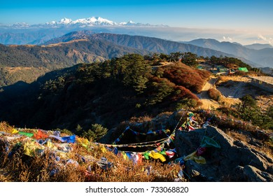 Tibetan prayer flag or Lung ta and Kangchenjunga high mountain range view from the Sandakphu , Darjeeling,  India