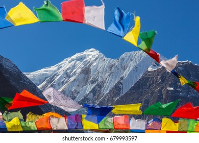 Tibetan prayer flags blowing in the wind, in the Himalayas, Nepal