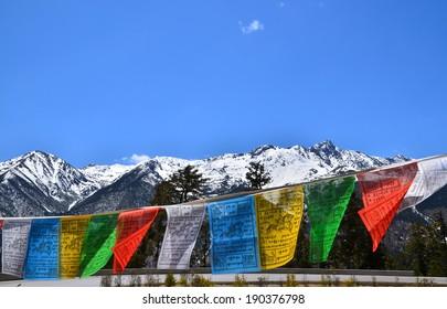 Tibetan Prayer Flags on Snow Mountain