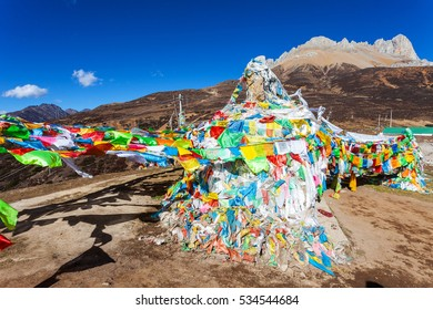 Tibetan Prayer Flags at snow mountains in Yunnan, China.